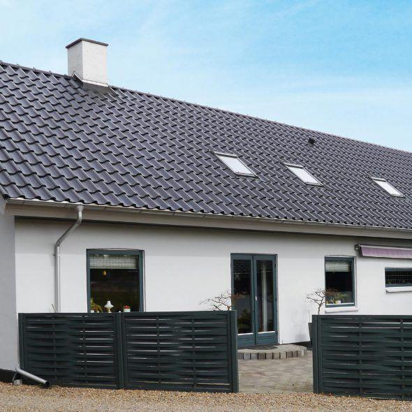 Einfamilienhaus mit Großfalzziegel Z9 in Brillan nero